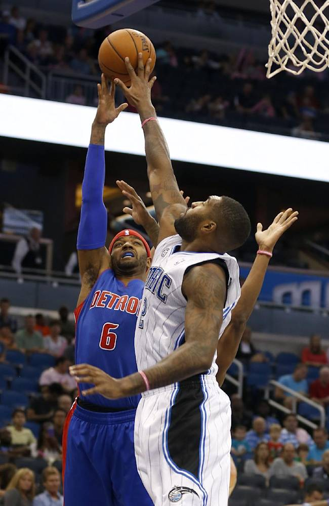 Detroit Pistons forward Josh Smith (6) shoots over Orlando Magic forward Kyle O'Quinn (2) during the first half of an NBA basketball game on Sunday,  Oct.  20, 2013, in Orlando, Fla