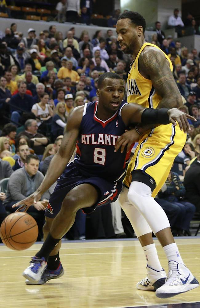 Atlanta Hawks guard Shelvin Mack (8) pushes his way past Indiana Pacers guard Rasual Butler in the first half of an NBA basketball game in Indianapolis, Sunday, April 6, 2014