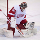 Detroit Red Wings goalie Jonas Gustavsson makes a save during first period NHL action Sunday, Dec. 1, 2013, in Ottawa. Gustavsson made 30 saves as the Red Wings defeated the Senators 4-2 The Associated Press