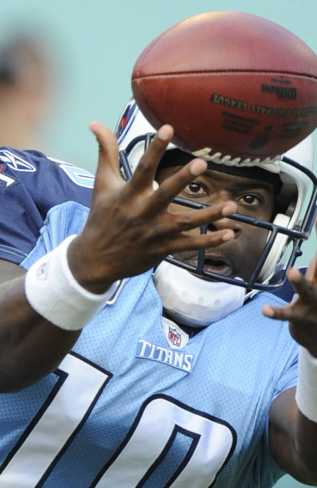 In a Nov. 14, 2010, file photo then Tennessee Titans quarterback Vince Young fumbles the ball during the second half of an NFL football game in Miami.  During a segment on a Tennessee radio show in 2012, callers claiming to be bartenders and servers at some of Young's favorite haunts testified to his largesse: routinely picking up the tab for teammates and just about everybody in the bar at a local T.G.I. Friday's restaurant  average cost $6,000 a night