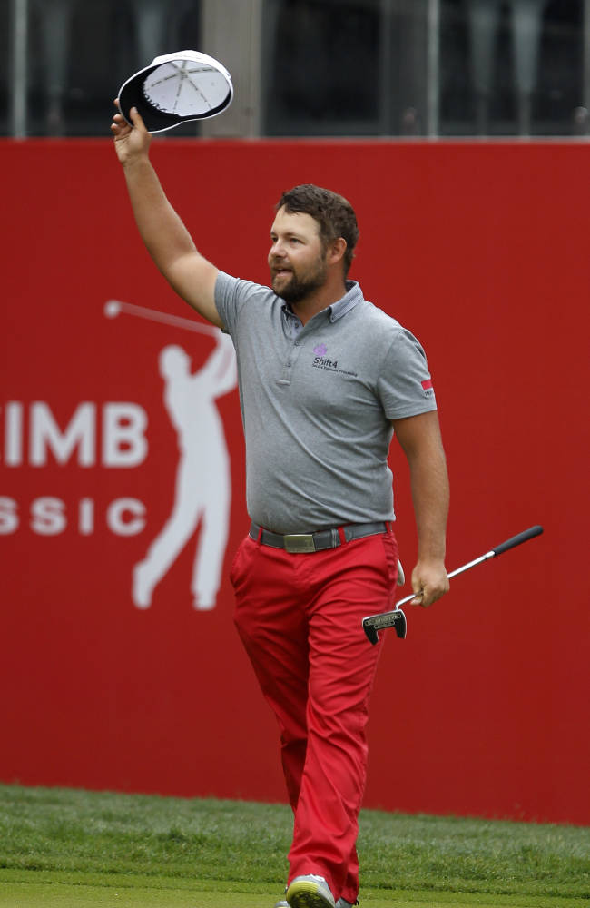 Ryan Moore wins CIMB Classic in playoff
