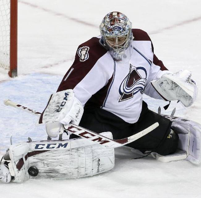Colorado Avalanche goalie Semyon Varlamov (1), of Russia, stops a shot from the Dallas Stars in the third period of an NHL hockey game, Monday, Jan. 27, 2014, in Dallas. Varlamov made 41 saves in the 4-3 Avalanche win