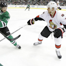 Ottawa Senators defenseman Marc Methot (3) ties to keep Dallas Stars left wing Ryan Garbutt (16) from the puck during the first period an NHL Hockey game, Saturday, March 22, 2014, in Dallas The Associated Press