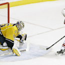 Arizona Coyotes center Antoine Vermette (50) scores against Nashville Predators goalie Pekka Rinne (35), of Finland, during a shootout at an NHL hockey game Tuesday, Oct. 21, 2014, in Nashville, Tenn. The Predators won the shootout to win the game 4-3 The