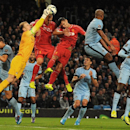 Manchester City goalkeeper Joe Hart, 2nd left, saves from a corner kick during the English Premier League soccer match between Manchester City and Liverpool at the Etihad Stadium, in Manchester, England, Monday, Aug. 25, 2014