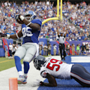 New York Giants tight end Daniel Fells (85) is pushed out of bounds after catching a touchdown pass against Houston Texans outside linebacker Whitney Mercilus (59) in the fourth quarter of an NFL football game, Sunday, Sept. 21, 2014, in East Rutherford,