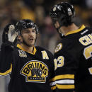Boston Bruins' Patrice Bergeron congratulates teammate Zdeno Chara (33) after their 3-2 win over the New York Rangers in a NHL hockey game in Boston Friday, Nov. 29, 2013 The Associated Press