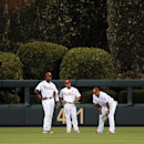 Philadelphia Phillies' Domonic Brown, left, Ben Revere, center, and Marlon Byrd watch a pitching change in the seventh inning of a baseball game against the Milwaukee Brewers on Thursday, April 10, 2014, in Philadelphia. The Brewers won 6-2 The Associated
