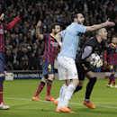 Barcelona goalkeeper Victor Valdes, Manchester City's Scott Sinclair, Barcelona's Gerard Pique, left, and Cesc Fabregas, center, react during their Champions League first knock out round soccer match at the Etihad Stadium, Manchester, England, Tuesday Feb