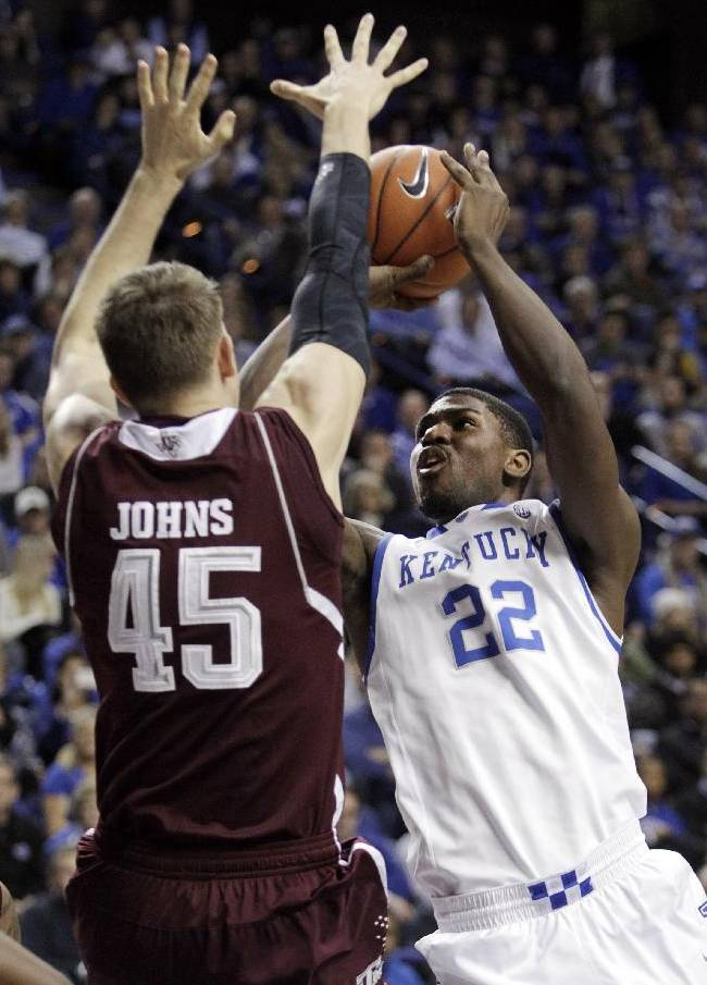 Kentucky's Alex Poythress (22) shoots near Texas A&M's Dylan Johns (45) during the second half of an NCAA college basketball game, Tuesday, Jan. 21, 2014, in Lexington, Ky. Kentucky won 68-51