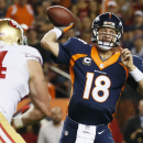Denver Broncos quarterback Peyton Manning (18) throws agains the San Francisco 49ers during the first half of an NFL football game, Sunday, Oct. 19, 2014, in Denver. (AP Photo/Jack Dempsey)