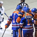 San Jose Sharks' Marc-Edouard Vlasic (44) watches as Edmonton Oilers' Jeff Petry (2), Justin Schultz (19) and Nail Yakupov (10) celebrate a goal during second period of an NHL hockey game in Edmonton, Alberta, Sunday, Dec. 7, 2014 The Associated Press