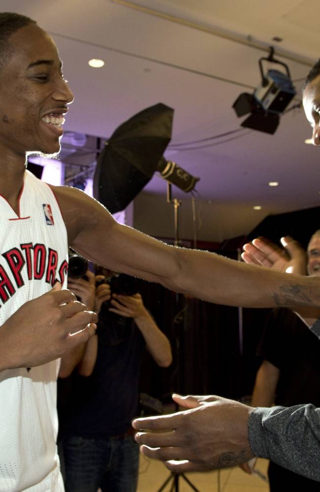 Toronto Raptors' Rudy Gay, right, and DeMar DeRozan joke around at the teams NBA basketball media day in Toronto, Monday Sept. 30, 2013 in Toronto