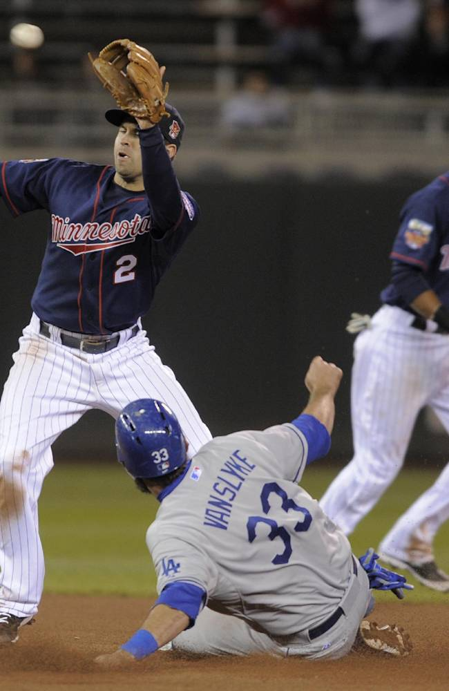 Los Angeles Dodgers' Scott Van Slyke (330 steals second base as Minnesota Twins second baseman Brian Dozier, left, takes a high throw during the seventh inning of the second half of a doubleheader of a baseball game in Minneapolis, Thursday, May 1, 2014. Twins shortstop Pedro Florimon, right, backs up the play. Dodgers won 4-3
