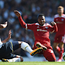 Tottenham Hotspur's Etienne Capoue, left, competes for the ball with West Bromwich Albion's Stephane Sessegnon during their English Premier League soccer match at White Hart Lane, London, Sunday, Sept. 21, 2014