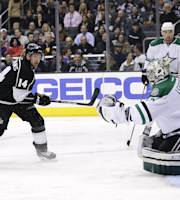 Dallas Stars goalie Kari Lehtonen, right, of Finland, makes a save off a shot by Los Angeles Kings' Justin Williams, left, during the second period of an NHL hockey game on Monday, Dec. 23, 2013, in Los Angeles. (AP Photo/Jae C. Hong)