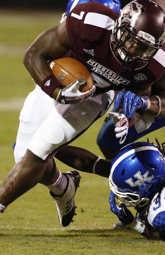 Mississippi State running back Nick Griffin (7) is tripped by Kentucky cornerback Fred Tiller (3) and defensive end Alvin Dupree in the second half of their NCAA college football game at Davis Wade Stadium in Starkville, Miss., Thursday, Oct. 24, 2013. Mississippi State won 28-22
