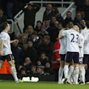 Everton's Romelu Lukaku, second right, holds up his arm as he celebrates with teammates after scoring his sides second goal in the first period of extra time during their English FA Cup third round replay soccer match between West Ham United and Everton a