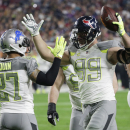 Houston Texans' J.J. Watt (99) is congratulated by Detroit Lions' Glover Quin after intercepting a pass during the first half of the NFL Football Pro Bowl Sunday, Jan. 25, 2015, in Glendale, Ariz. (AP Photo/David J. Phillip)