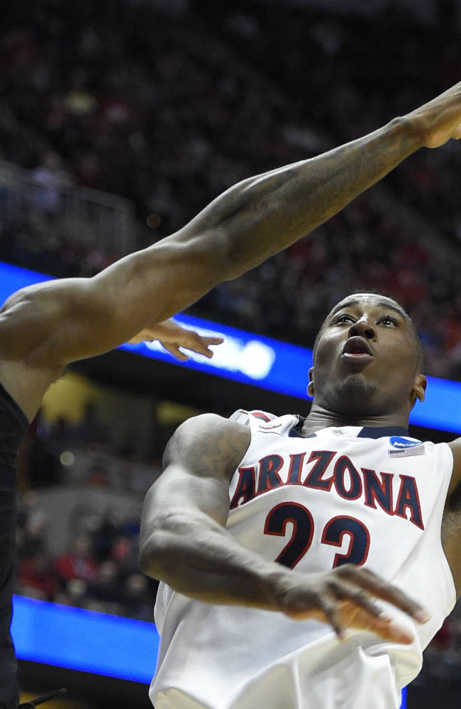 Arizona forward Rondae Hollis-Jefferson (23) shoots over San Diego State forward Winston Shepard (13) during the first half in a regional semifinal of the NCAA men's college basketball tournament, Thursday, March 27, 2014, in Anaheim, Calif