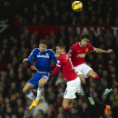 10ThingstoSeeSports - Manchester United's Rafael, right, and Chris Smalling fights for the ball against Chelsea's Eden Hazard, left, during the English Premier League soccer match between Manchester United and Chelsea at Old Trafford Stadium, Manchester,