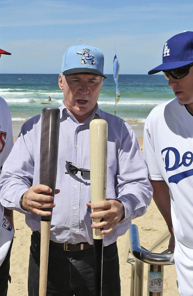 Major League baseball players Los Angeles Dodgers catcher A.J. Ellis and Arizona Diamondbacks pitcher Patrick Corbin, chat with former Australian cricket captain Allan Border during a visit to Manly Beach in Sydney Wednesday, Nov. 20, 2013. The Dodgers and the Diamondbacks will play in their two-game series in Australia that opens next year's Major League Baseball season