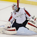 Washington Capitals goalie Braden Holtby deflects a shot by the New Jersey Devils during the third period of an NHL hockey game, Saturday, Dec. 6, 2014, in Newark, N.J. The Capitals won 4-1 The Associated Press