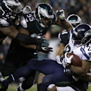 Seattle Seahawks' Marshawn Lynch (24) is tackled during the first half of an NFL football game against the Philadelphia Eagles, Sunday, Dec. 7, 2014, in Philadelphia The Associated Press