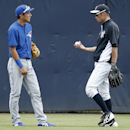 Toronto Blue Jays infielder Munenori Kawasaki, left, talks to New York Yankees outfielder Ichiro Suzuki in the outfield before a spring exhibition baseball game between their two teams in Tampa, Fla., Sunday, March 23, 2014 The Associated Press