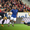 Lille's Marko Basa of Serbia, left, kicks the ball as he vies for the ball with Everton's Samuel Eto'o, center, during their Europa League soccer match at the Lille Metropole stadium, in Villeneuve d'Ascq, northern France, Thursday, Oct. 23, 2014. (AP Pho
