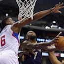New Orleans Pelicans forward Tyreke Evans, right, shoots as Los Angeles Clippers center DeAndre Jordan defends during the first half of an NBA basketball game, Saturday, March 1, 2014, in Los Angeles The Associated Press