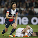 PSG's Edinson Cavani reacts after being penalised for a challenge on Chelsea's Gary Cahill, right, during the Champions League quarterfinal first leg soccer match between PSG and Chelsea, at the Parc des Princes stadium, in Paris, Wednesday, April 2, 2014