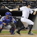 New York Yankees' Brett Gardner, right, hits an RBI-single as Chicago Cubs catcher Welington Castillo, left, looks on during the fourth inning of Game 2 of an interleague baseball doubleheader on Wednesday, April 16, 2014, at Yankee Stadium in New York Th