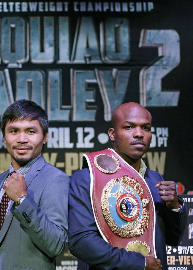 Boxer Manny Pacquiao, of the Phillipines, left, poses for a photo with Timothy Bradley of Indio, Ca., the current WBO World Welterweight champion, during a press conference,Thursday, Feb. 6, 2014, in New York.  The pair will face off in a rematch April 12, 2014, in Las Vegas. Bradley won their first encounter