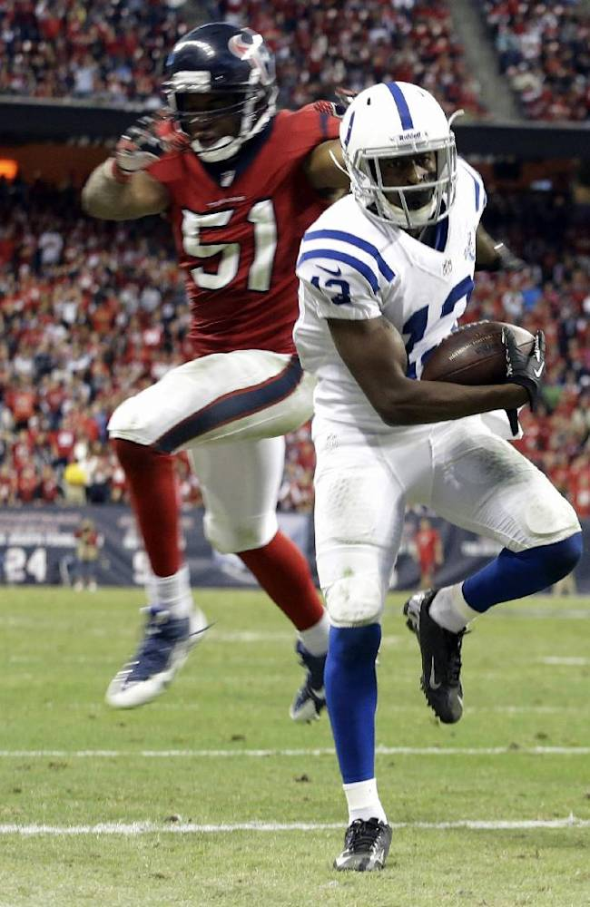Indianapolis Colts' T.Y. Hilton scores in front of Houston Texans' Darryl Sharpton (51) during the fourth quarter of an NFL football game Sunday, Nov. 3, 2013, in Houston