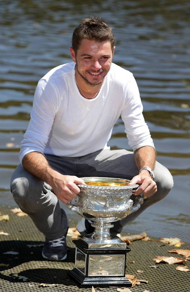 Switzerland's Stanislas Wawrinka poses with his Australian Open trophy on the banks of the Yarra River following his win over Spain's Rafael Nadal on Sunday evening in Melbourne, Australia, Monday, Jan. 27, 2014