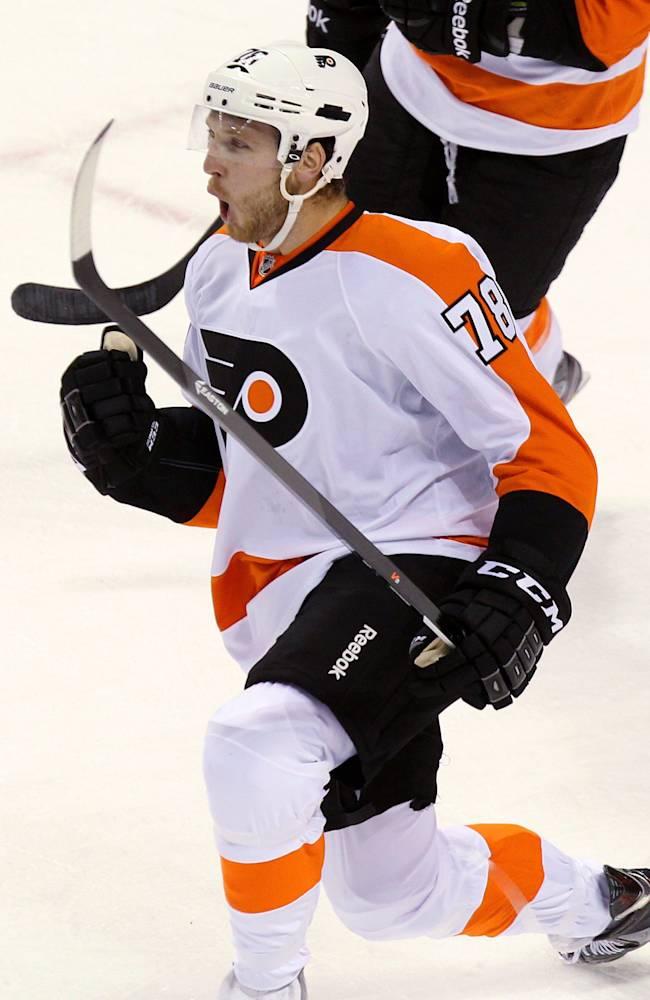 Philadelphia Flyers' Doug Clarkson celebrates after scoring a goal in the first period of an NHL preseason game against the Toronto Maple Leafs, Sunday, Sept. 15, 2013, in London, Ontario