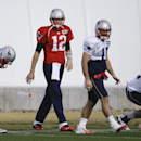 New England Patriots quarterback Tom Brady (12) warms up with teammates, including wide receiver Julian Edelman (11), during practice Wednesday, Jan. 28, 2015, in Tempe, Ariz. The Patriots play the Seattle Seahawks in NFL football Super Bowl XLIX Sunday,