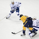 Tampa Bay Lightning center Tom Pyatt (11) passes the puck to Lightning right wing J.T. Brown (23) as Nashville Predators forward Craig Smith (15) defends in the first period of an NHL hockey game, Thursday, Feb. 27, 2014, in Nashville, Tenn The Associated