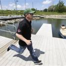 NASCAR driver Justin Allgaier runs to a boat during a relay race to promote the DuPont Pioneer 250 NASCAR Nationwide Series auto race to be held in June at the Iowa Speedway, Monday, May 20, 2013, in Des Moines, Iowa. Allgaier is 4th in the Nationwide standings even though a win has eluded him so far in 2013. (AP Photo/Charlie Neibergall)