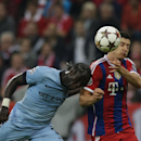 Manchester City's Bacary Sagna, left, and Bayern's Robert Lewandowski, right, challenge for the ball during the Champions League Group E soccer match between FC Bayern Munich and Manchester City at Allianz Arena in Munich, southern Germany, Wednesday Sept