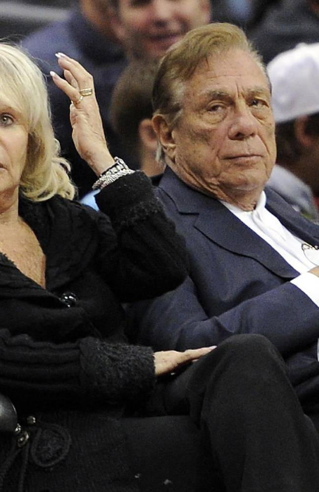 In this Nov. 12, 2010, file photo, Los Angeles Clippers owner Donald T. Sterling, right, sits with his wife Rochelle during the Clippers NBA basketball game against the Detroit Pistons in Los Angeles. An attorney representing the estranged wife of Clippers owner Donald Sterling said Thursday, May 8, 2014, that she will fight to retain her 50 percent ownership stake in the team