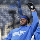 Los Angeles Dodgers shortstop Hanley Ramirez throws the ball from his glove during warmups before a baseball game against the Los Angeles Dodgers Wednesday, April 2, 2014, in San Diego The Associated Press