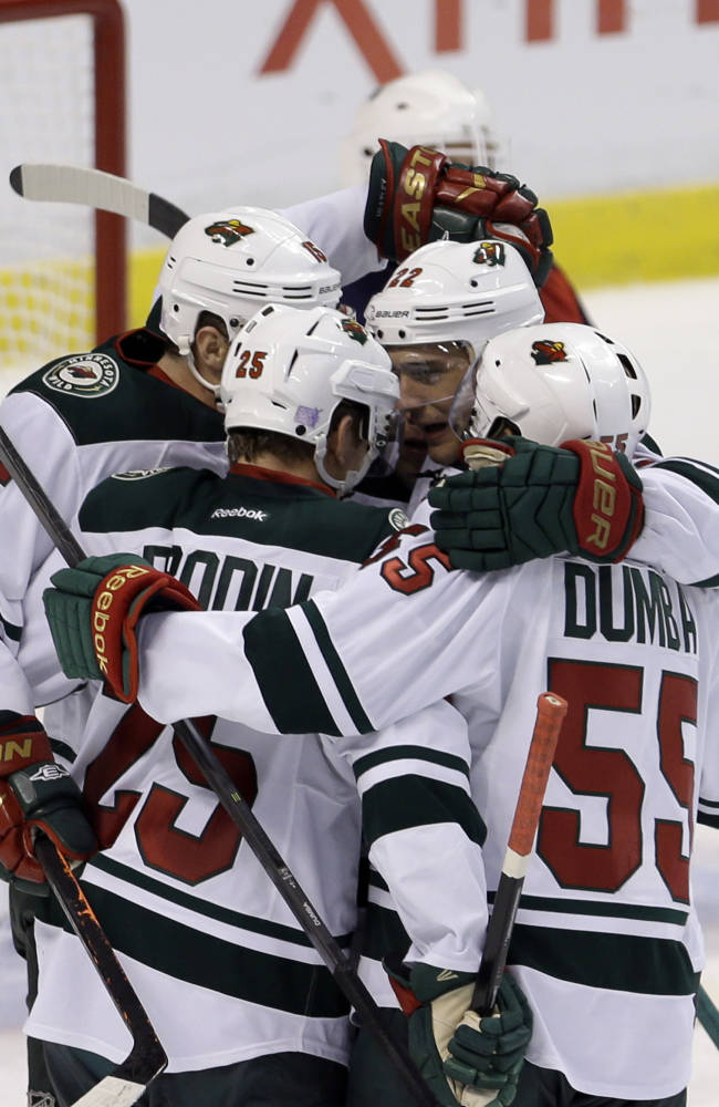 Minnesota Wild defenseman Jonas Brodin (25) is congratulated by teammates after scoring a goal against the Florida Panthers in the second period of an NHL hockey game, Saturday, Oct. 19, 2013, in Sunrise, Fla