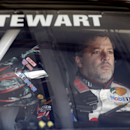 NASCAR driver Tony Stewart (14) sits in his car during final practice for the NASCAR Sprint Cup Series auto race at Chicagoland Speedway in Joliet, Ill., Saturday, Sept. 13, 2014. (AP Photo/Nam Y. Huh)