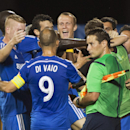 Montreal Impact's Marco Di Vaio celebrates with teammates after scoring against L.A. Galaxy during the first half of a soccer game, Wednesday, Sept. 10, 2014 in Montreal The Associated Press