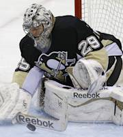 Pittsburgh Penguins goalie Marc-Andre Fleury (29) blocks a shot in the first overtime period of a first-round NHL playoff hockey game against the Columbus Blue Jackets in Pittsburgh, Saturday, April 19, 2014. (AP Photo/Gene J. Puskar)