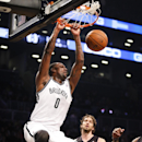 Brooklyn Nets center Andray Blatche (0) dunks as Los Angeles Lakers center Pau Gasol (16), center, looks on in the first quarter of a NBA basketball game at the Barclays Center, Wednesday, Nov. 27, 2013, in New York The Associated Press