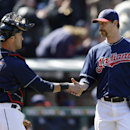 Cleveland Indians relief pitcher John Axford, right, is congratulated by catcher Yan Gomes after the Indians defeated the Padres 2-0 in the first baseball game of a doubleheader, Wednesday, April 9, 2014, in Cleveland The Associated Press