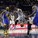 Charlotte Bobcats' Kemba Walker (15) is fouled as he drives between Golden State Warriors' Jermaine O'Neal (7) and Draymond Green during the first half of an NBA basketball game in Charlotte, N.C., Monday, Dec. 9, 2013 The Associated Press